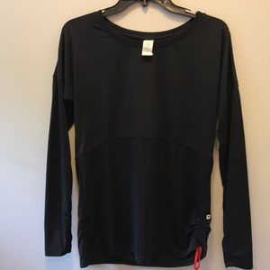 Fabletics long sleeved top with cinched sides.